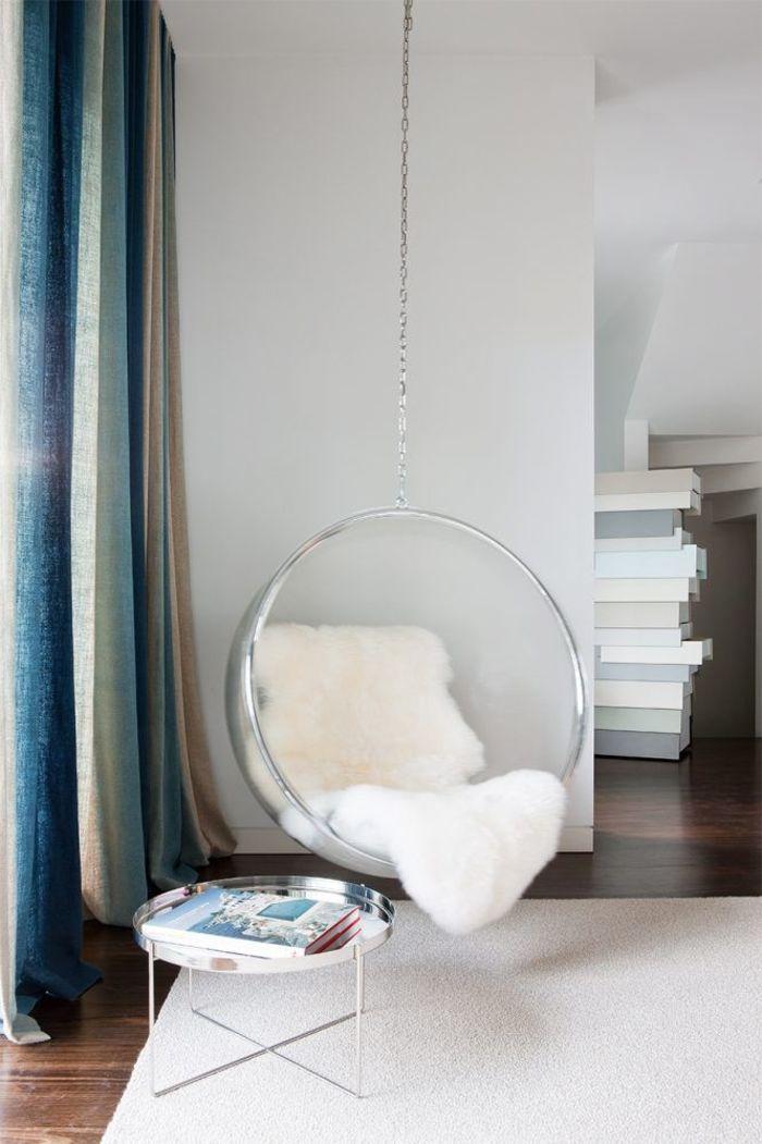 Современная кресло-качалка в углу гостиной. Фото: Hecker Guthrie
