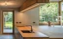 Одно целое: комнаты разного размера собраны в один красивый объем