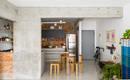 Чувственность бетона и брутализм обнаженного кирпича в бразильской квартире