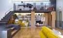 Бывший склад был преобразован в двухуровневую квартиру