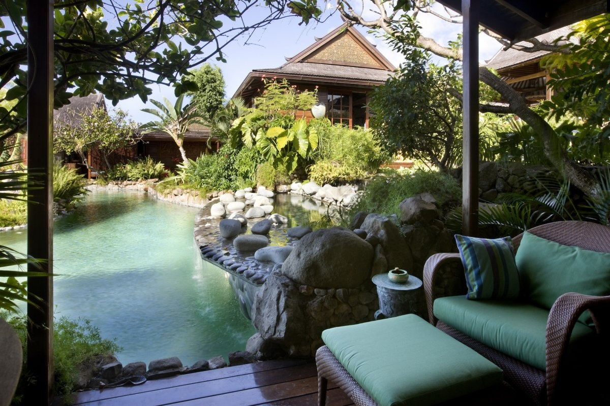 the-homes-rooms-are-situated-around-an-interior-network-of-koi-ponds-and-waterfalls
