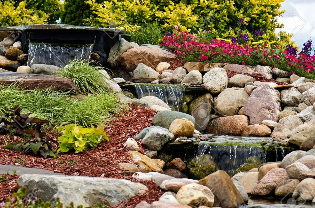 5179317-a-waterfall-flowing-in-a-rock-garden--stock-photo-landscaping