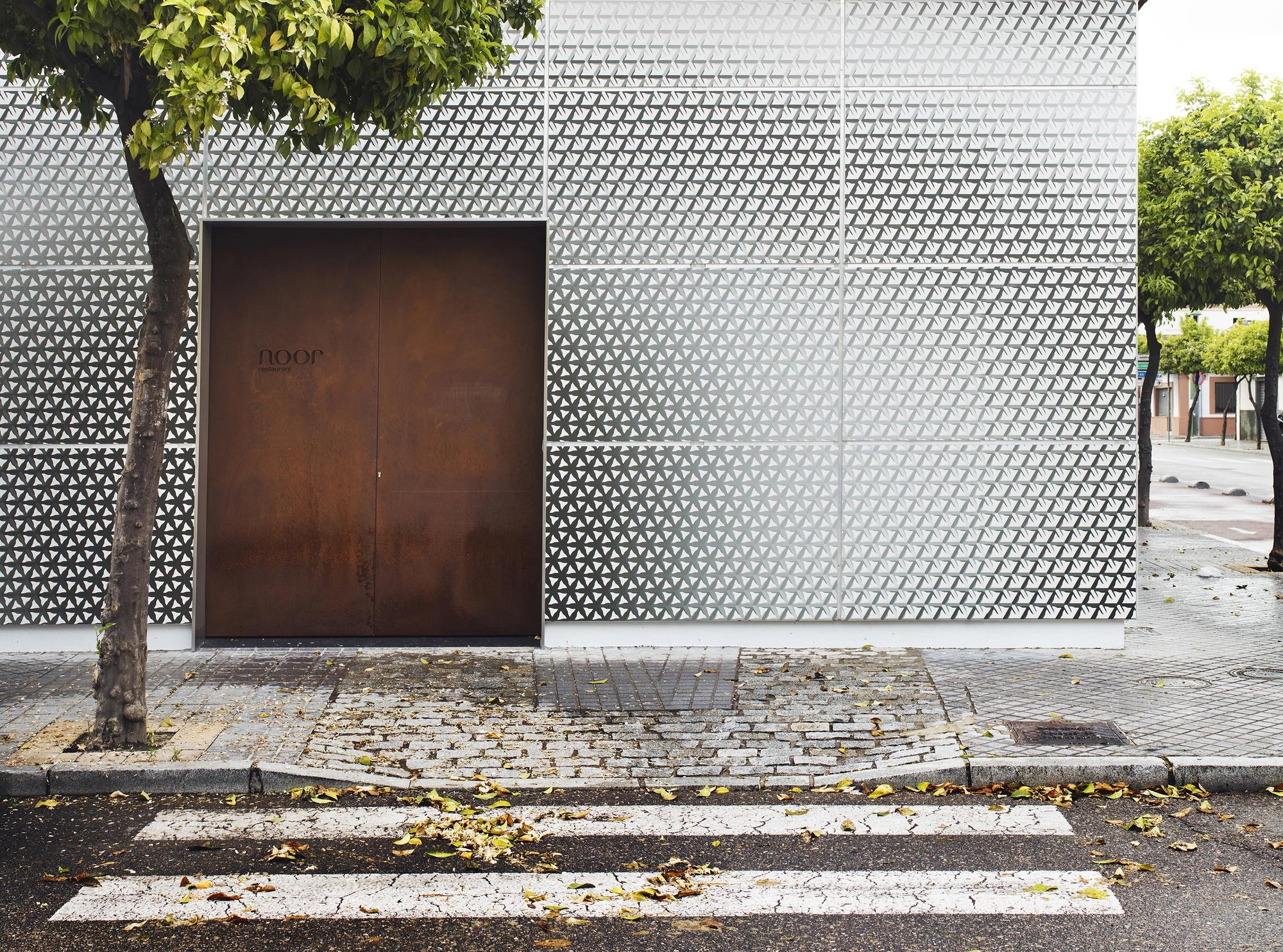 1south_facade__corten_steel_door_shows_the_entrance_to_the_restaurant