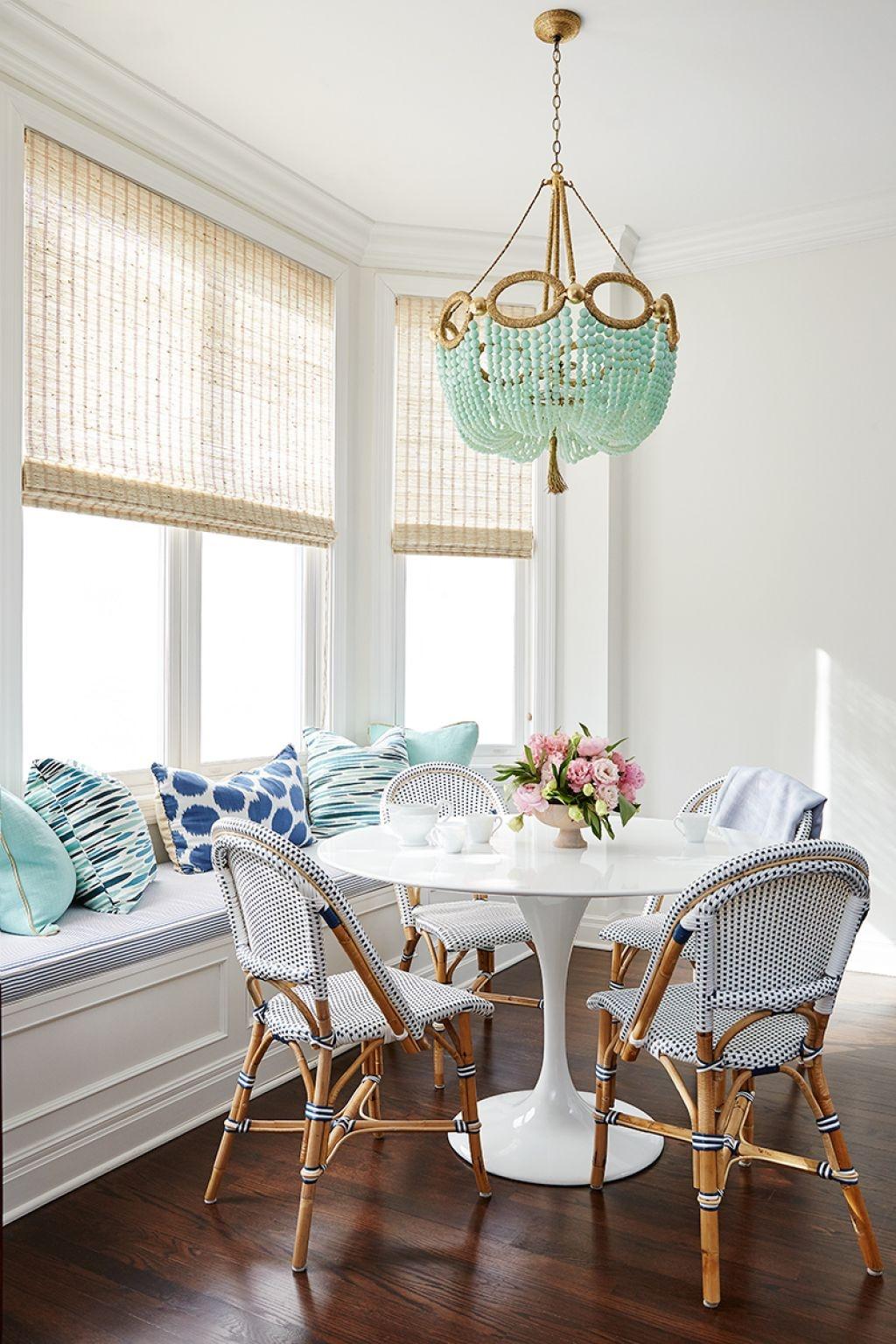 breakfast-nook-with-hanging-beaded-chandelier-over-furniture