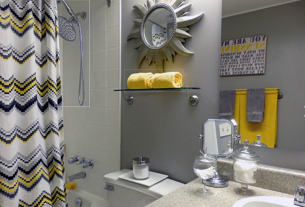pops-of-yellow-enliven-modern-bathroom-in-gray