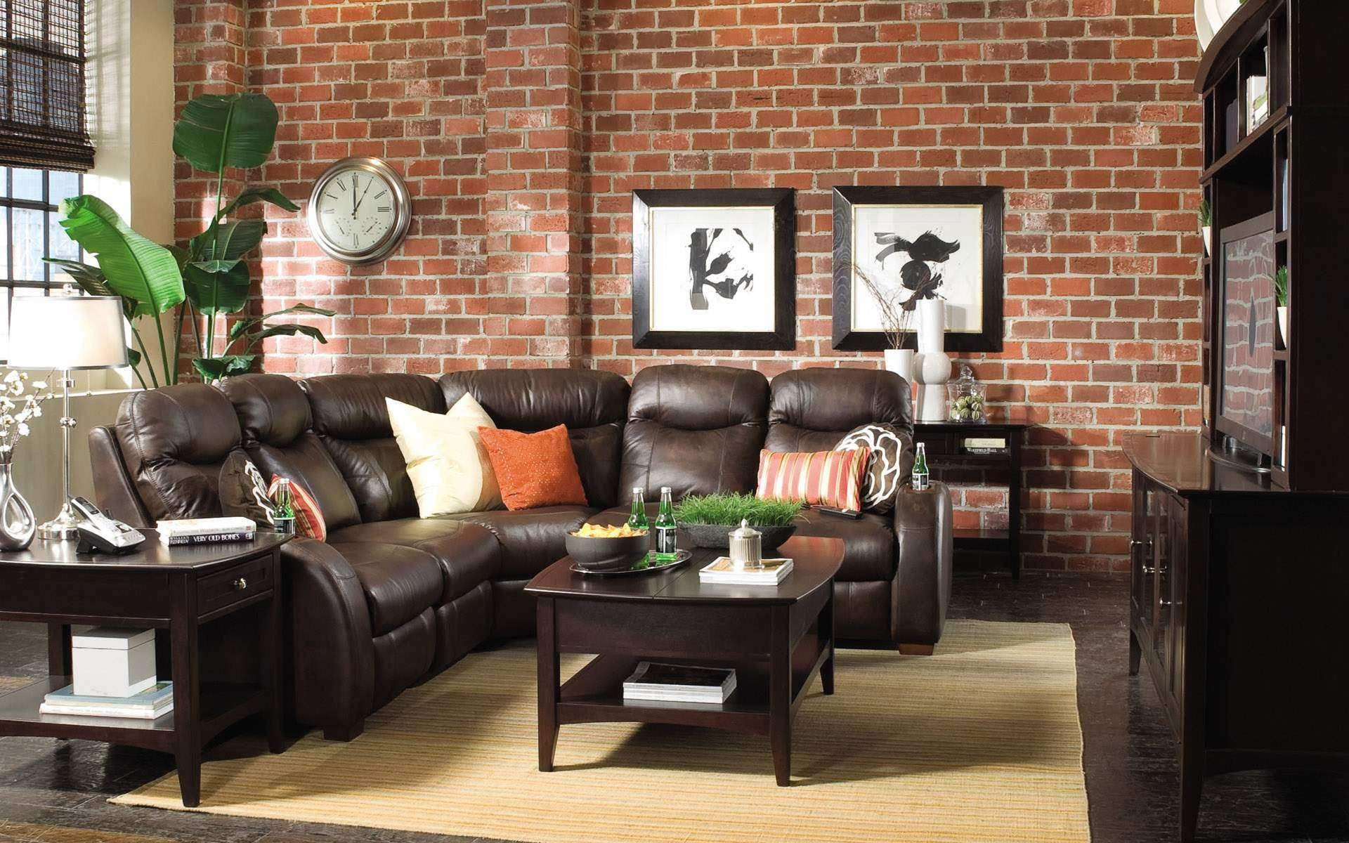 amazing-exposed-brick-wall-with-black-for-living-room-decoration-two-classic-black-wooden-framed-photos-artificial-plants-rounded-clock-on-the-exposed-bric