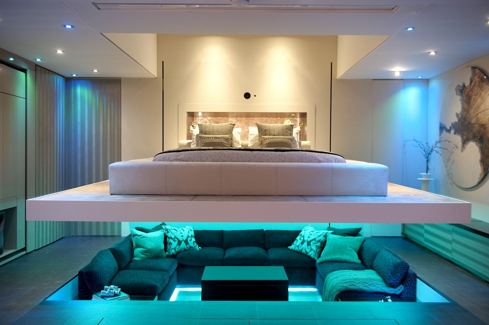 wonderful-sunken-seat-area-with-rug-area-on-bottom-with-bluish-light-on-modern-apartment