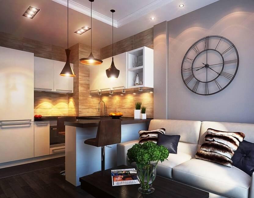 Красивая кухня со всей необходимой мебелью, барной стойкой и диваном