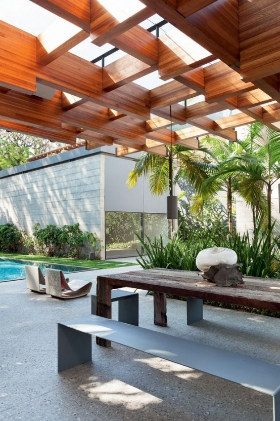 modern-home-filled-with-greenery-wood-and-artworks-2-554x831