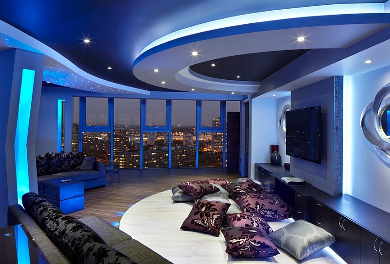 stunning-space-with-view-of-london-skyline-and-lighting-that-adds-a-blue-hue-to-the-room