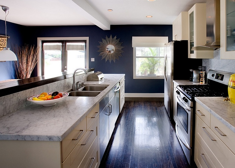 white-carrera-marble-cream-cabinets-and-navy-blue-walls-define-this-trendy-kitchen