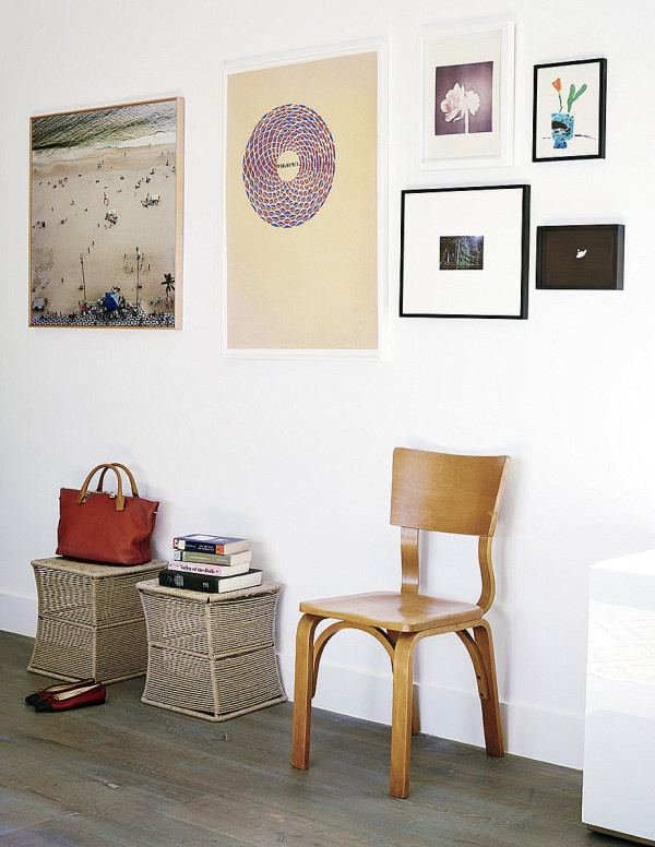wall-of-artwork-in-an-eclectic-hallway