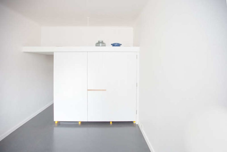 02-the-kitchen-piece-can-be-completely-closed-with-white-doors-to-make-it-invisible-in-the-interior-and-theres-storage-space-on-its-top-775x517