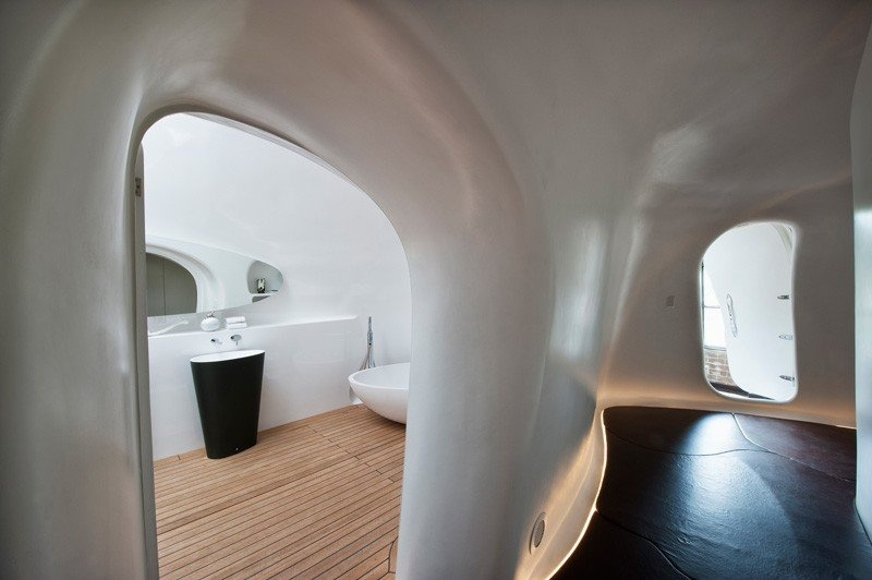 unique-warehouse-conversion-with-sculptural-cave-inside-it-7
