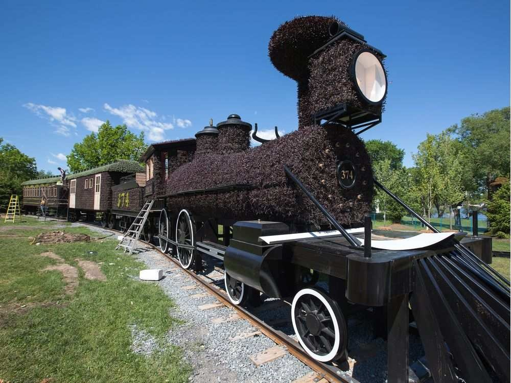 a-train-engine-and-passenger-cars-as-we-get-a-sneak-peek-tou.