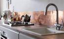 Металлическая плитка на кухне: защита стен от жира и копоти